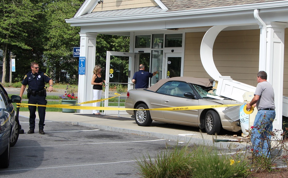 Driver takes out Cape Cod Times newspaper dispenser… [Photos]