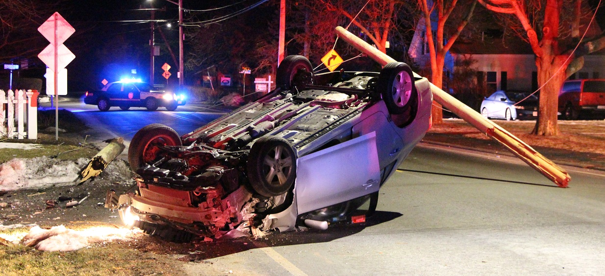 PHOTOS: Pole snapped during rollover, one to jail…