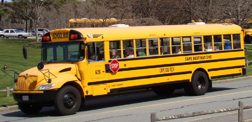 "DRAMA:  Child waiving ""HELP US"" sign from school bus on Mid-Cape Highway…"
