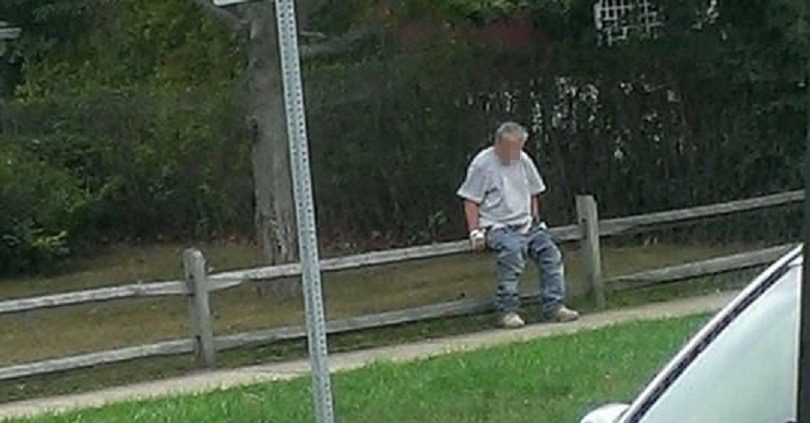 BIZARRE HYTOWN PHOTO:  Man defecating on Main Street… right in front of rush hour traffic!