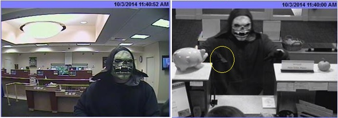 Robber in skeleton mask brandished black semi-automatic pistol…