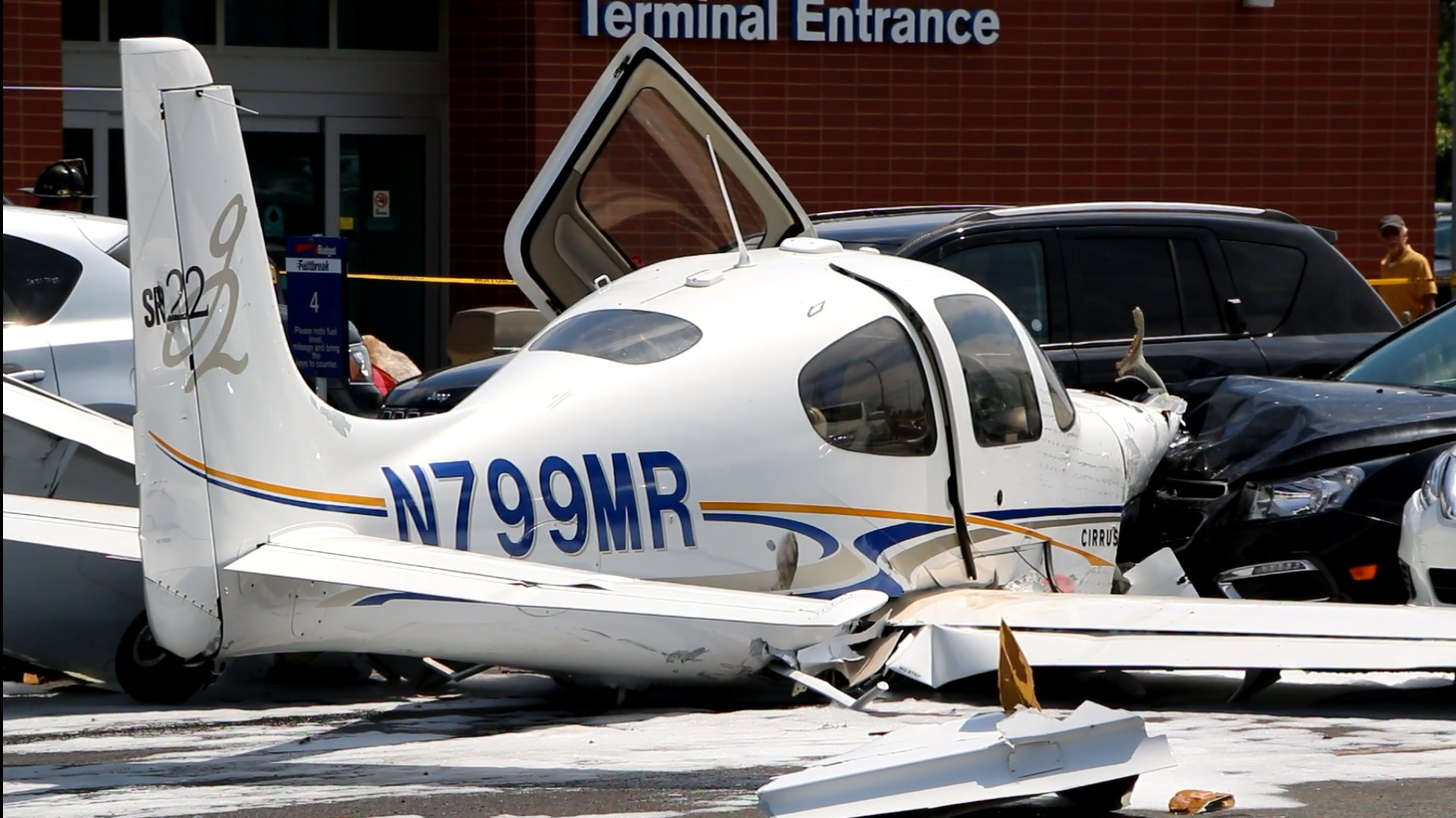 VIDEO: Single prop plane crashes through fence and into cars at Barnstable Municipal Airport…
