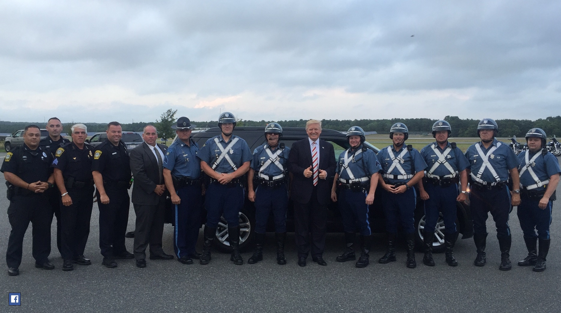 SHARP PHOTO: Trump takes time to pose with local members of protection detail…